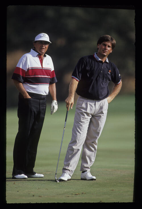 Fred Couples and Raymond Floyd both leaning the same way on the fairway during the 1990 RMCC Invitational