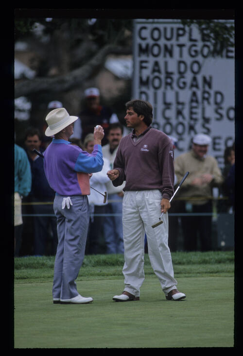 Tom Kite and Fred Couples inspecting a golf ball on the green during the 1992 US Open