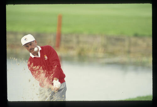 The sand flies as Mark James exits a bunker during the 1993 Ryder Cup
