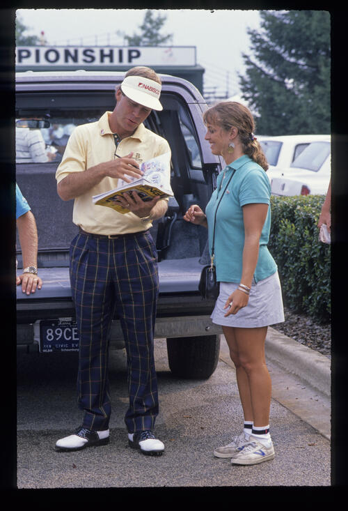 Ben Crenshaw signing an autograph during the 1989 USPGA