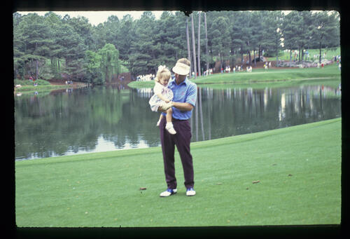 Ben Crenshaw and his daughter during the 1989 Masters Par Three Tournament