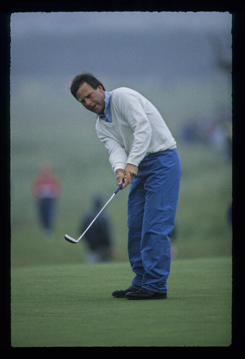 Ben Crenshaw putting in foul weather during the 1987 Open Championship