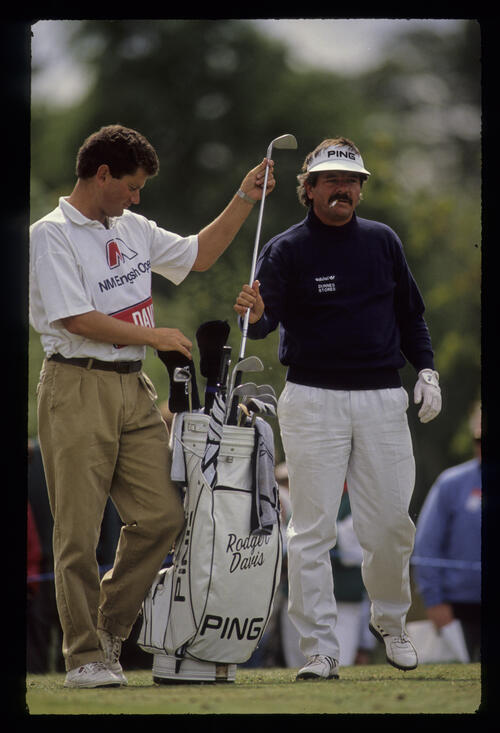 Rodger Davis selecting iron on the tee during the 1990 English Open