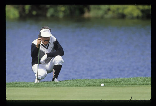 Rodger Davis lining up a putt from the fringe in front of a lake