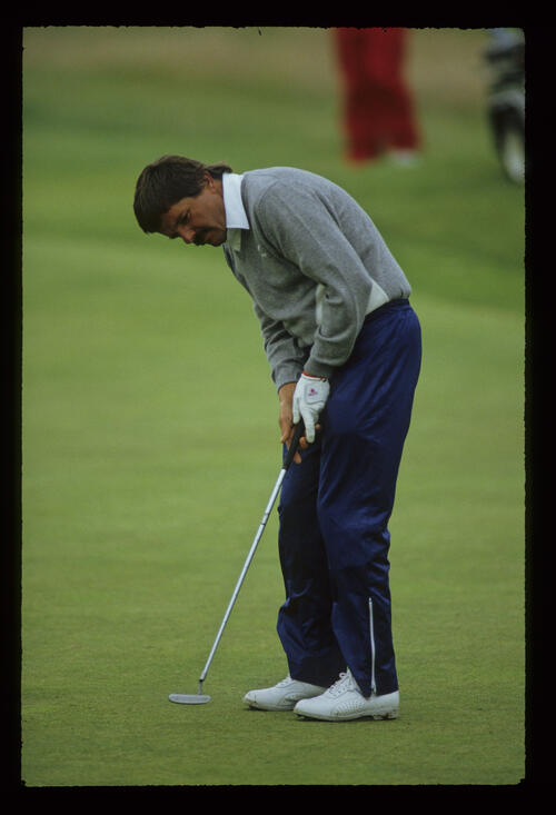 Rodger Davis putting during the 1987 Open Championship