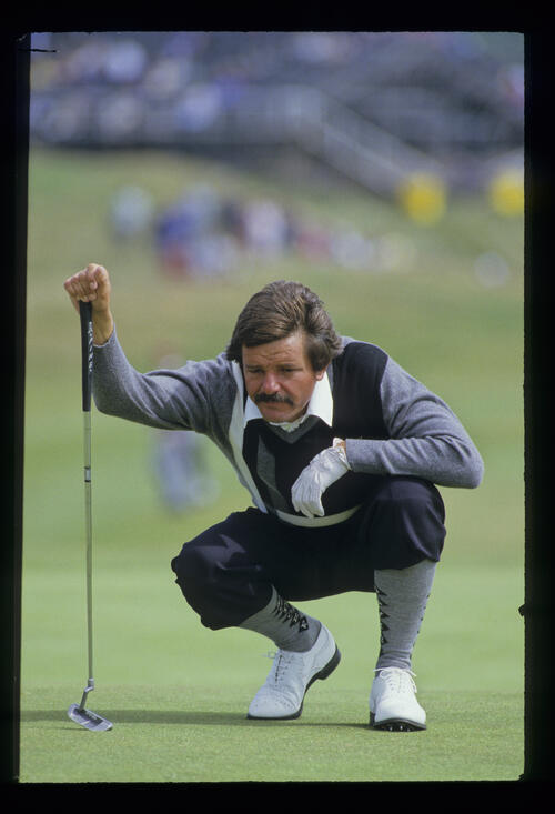Rodger Davis lining up a putt during the 1986 Open Championship