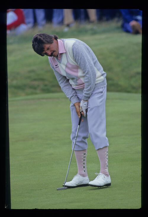 Rodger Davis concentrating over a putt during the 1986 Open Championship