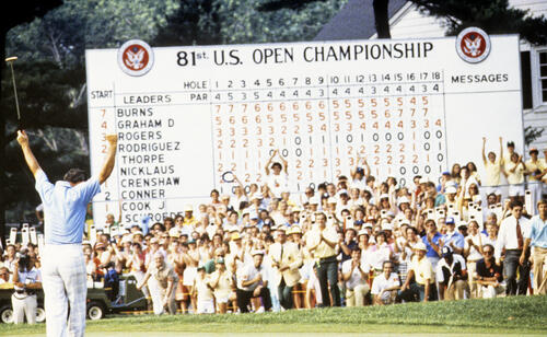 David Graham celebrating in front of the scoreboard after winning the 1981 US Open