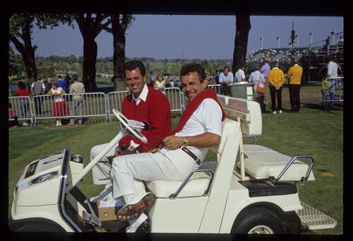 Tony Jacklin and Bernard Gallacher riding a buggy in the sunshine during the 1989 Ryder Cup