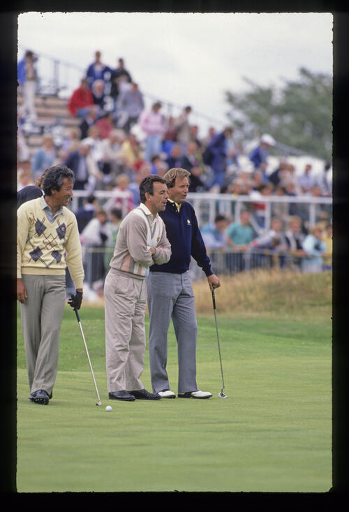 Tony Jacklin, Isao Aoki and Ray Floyd on the green during the 1988 Open Championship
