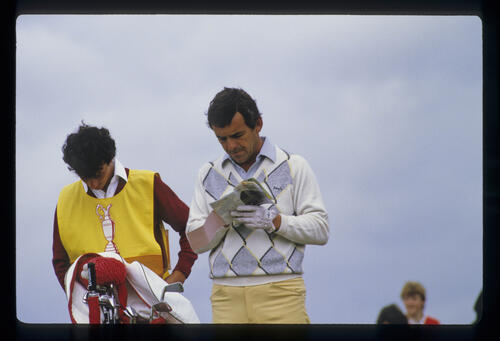 Tony Jacklin checking yardages from the tee during the 1985 Open Championship