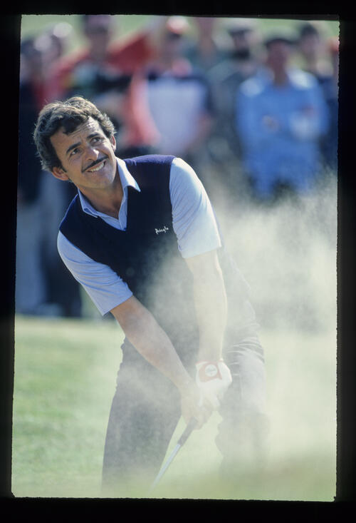 Tony Jacklin splashing from a bunker during the 1982 Martini International