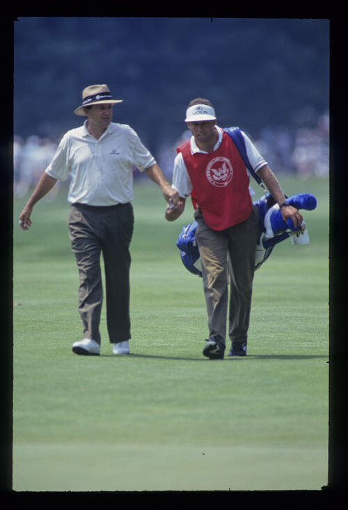 Raymond Floyd and his caddie with a sense of purpose on the fairway during the 1993 US Open