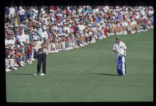 Raymond Floyd hits from the fairway in front of a huge gallery during the 1993 Masters