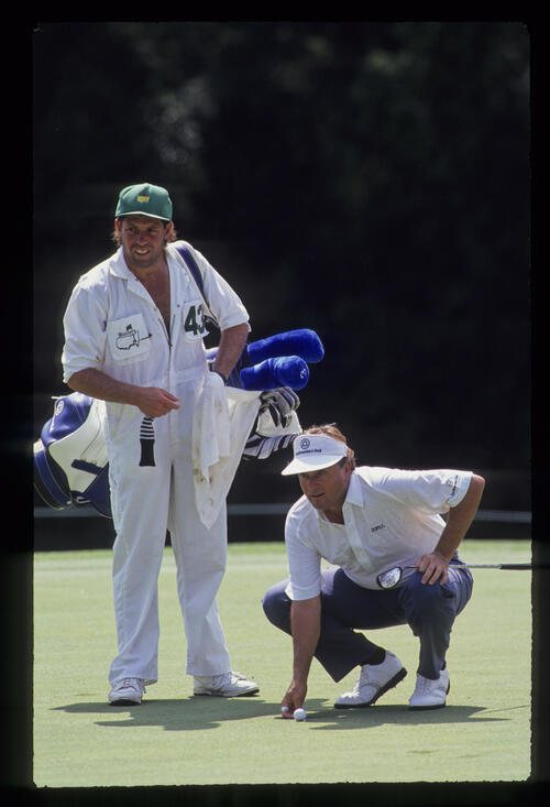 Raymond Floyd and his caddie in deep thought over a putt during the 1991 Masters