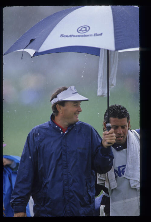 Raymond Floyd finds something to smile about during the rain shortened 1991 Nestle Invitational
