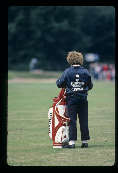 Bernard Langer's caddie, with trousers rolled up, during the 1984 Suntory World Matchplay