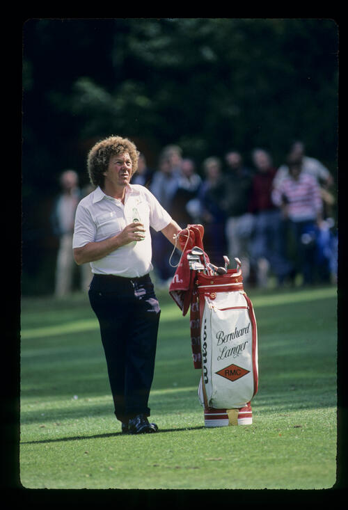 Bernhard Langer's caddie on the fairway during the 1984 Suntory World Matchplay