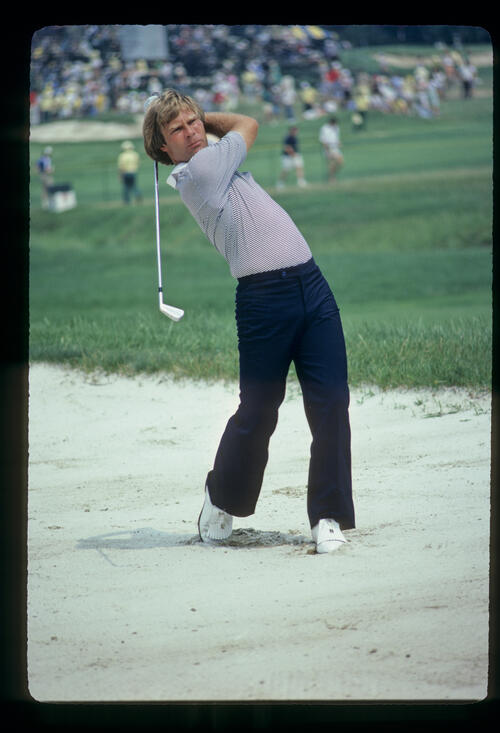 Ben Crenshaw hitting from a bunker during the 1981 US Open