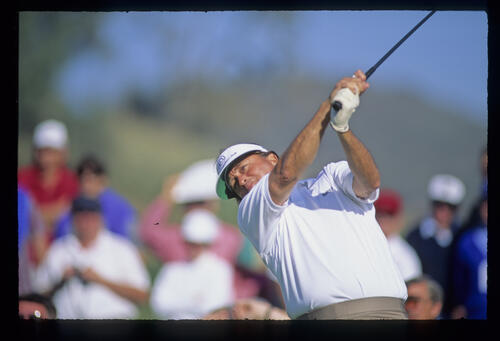 Raymond Floyd extends through the ball as he drives during the 1990 Ronald McDonald Children's Charity Tournament