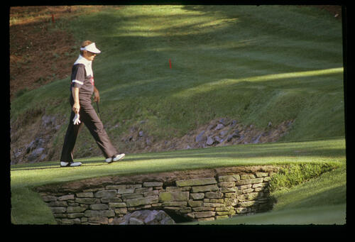 Raymond Floyd looks pensive as he crosses a bridge to a green during the 1990 Masters