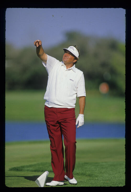 Raymond Floyd tests the wind during the 1987 Hertz Bay Hill Classic
