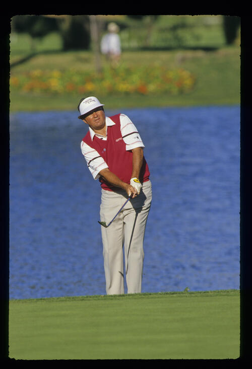 Raymond Floyd chips to the green from the lakeside during the 1987 TPC