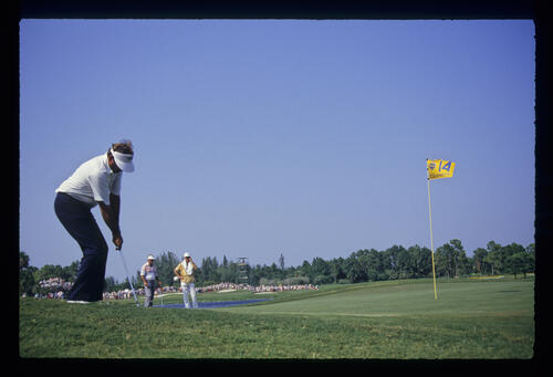 Raymond Floyd chips to the 14th green from thick, greenside rough during the 1987 USPGA