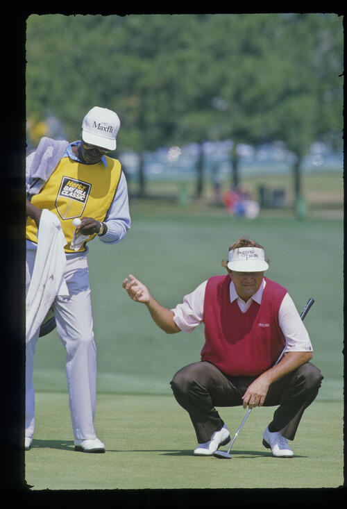 Raymond Floyd waiting for his ball as his caddie cleans it on the green during the 1987 Hertz Bay Hill Classic