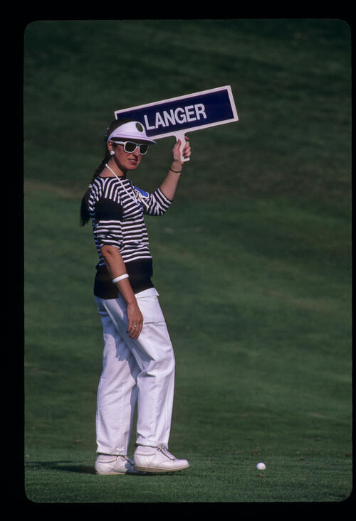 The ball marker doing her job in the sun during the 1985 Suntory World Matchplay