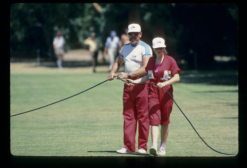 A power cable being moved during the 1984 Australian Masters