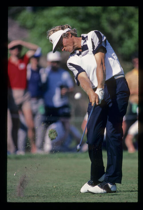 Bernhard Langer staying down through the ball on the fairway during the 1984 USF&G Classic