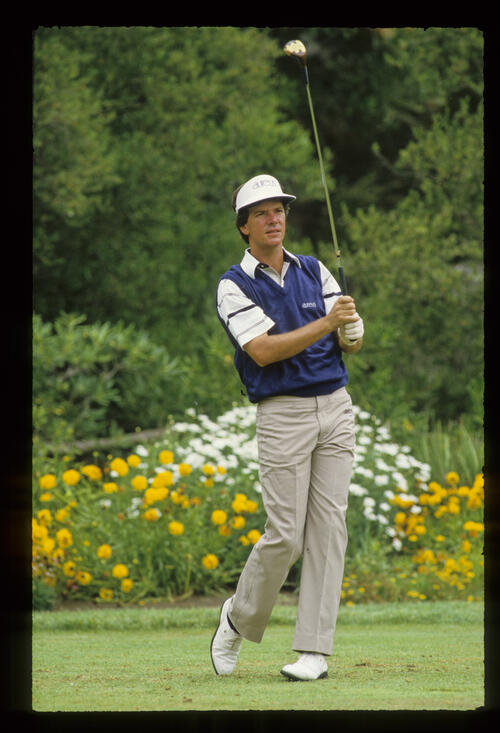 Larry Mize watching his drive closely during the 1987 US Open