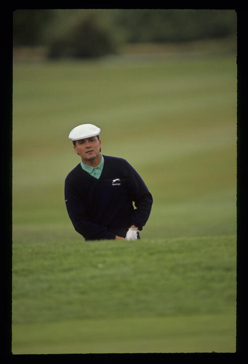 Mark McNulty splashing from a bunker during the 1990 NM English Open