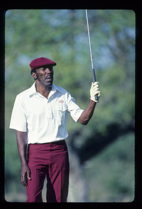Calvin Peete looking anxious after driving on his way to winning the 1985 TPC