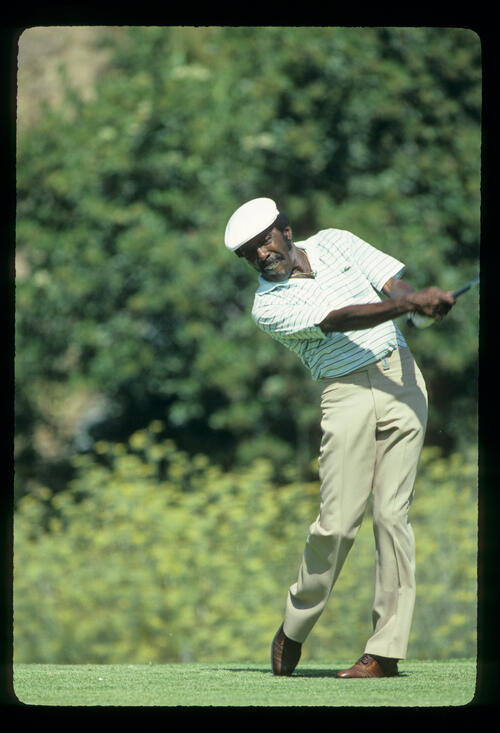 Calvin Peete extending through the ball during the 1983 USPGA