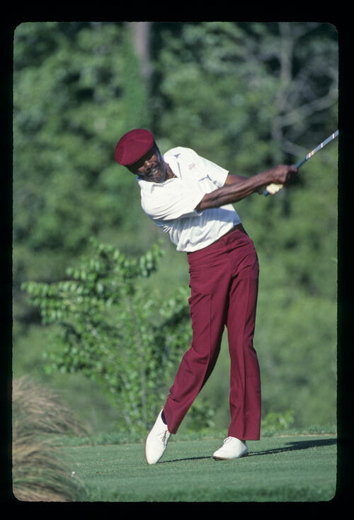 Calvin Peete extending through the ball on his way to winning the 1985 TPC