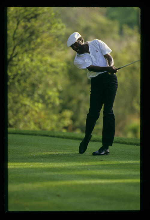 Calvin Peete following through on the tee during the 1988 TPC