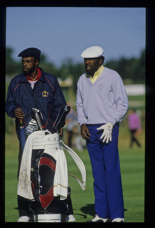Calvin Peete and his caddie considering their options during the 1985 Ryder Cup