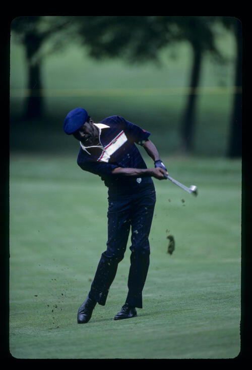 Calvin Peete punching through the ball on the fairway during the 1986 NEC World Series of Golf