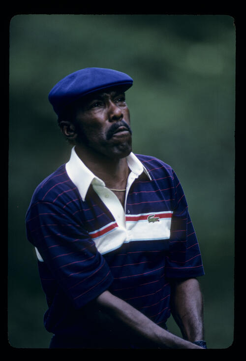 Calvin Peete watching his shot closely during the 1986 NEC World Series of Golf