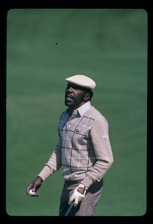 Calvin Peete reacting to a putt during the 1986 Masters