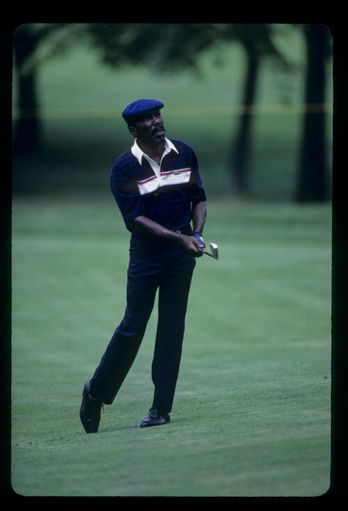 Calvin Peete watching the result of his approach shot during the 1986 NEC World Series of Golf