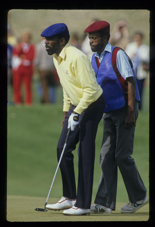 Calvin Peete and his caddie lining up a putt during the 1987 Phoenix Open
