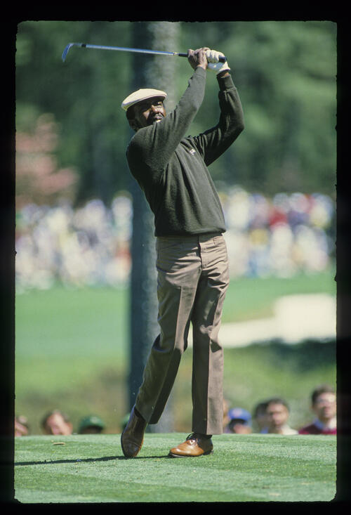 Calvin Peete hands high on the tee during the 1985 Masters