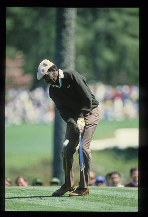 Calvin Peete just after impact on the tee during the 1985 Masters