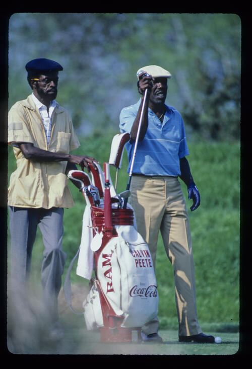 Calvin Peete and his caddie considering their options during the 1986 TPC