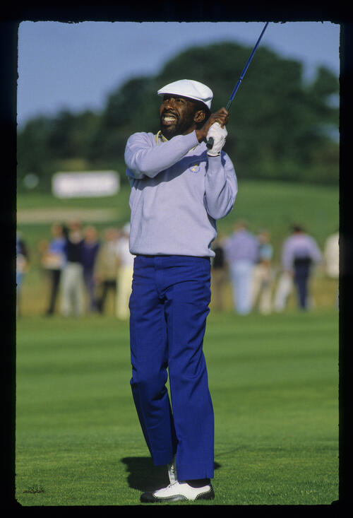 Calvin Peete watching his fairway shot closely during the 1985 Ryder Cup