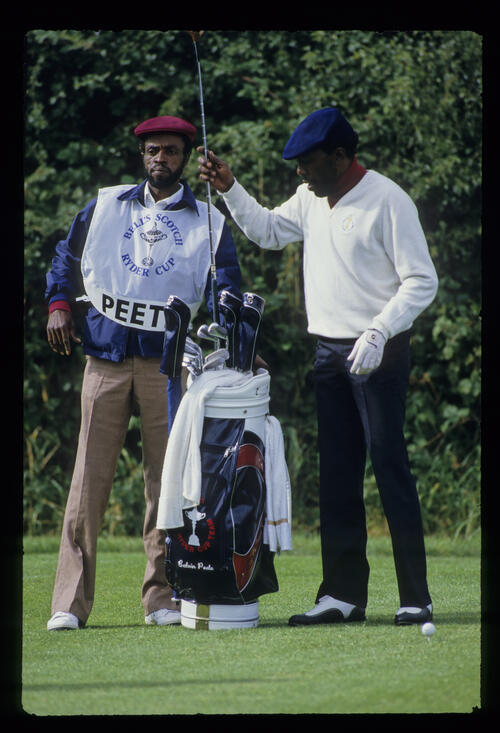 Calvin Peete and his and his caddie making their club selection during the 1985 Ryder Cup