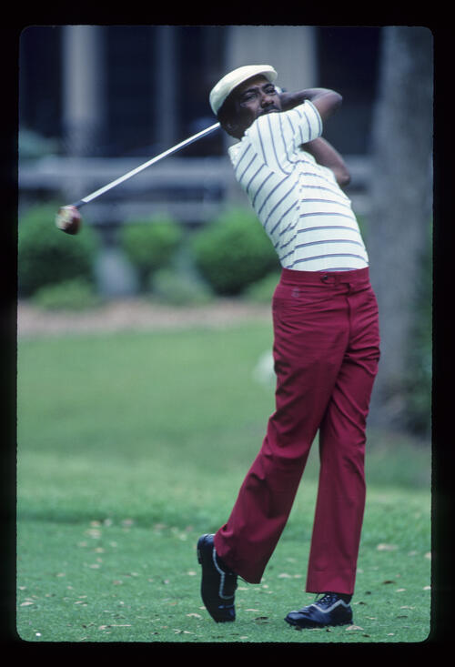 Calvin Peete following through on the tee during the 1983 TPC